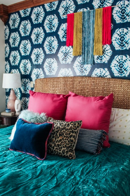 Colorful eclectic glam meets the southwest in designer Sarisa Munoz of The Indigo Leopard Home's guestroom. See how she turned SmithHönig's luxurious fabric and colorful peel and stick wallpaper into a family DIY project.