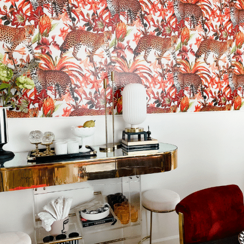 For her recent dining room project, friend and interior decorator Tiffany Brown based the space around one specific item: SmithHönig's new Pantera peel & stick wallpaper. The end result is a luxe, dramatic space that is anything but tame. Read on to see how Tiffany achieved this bold, sexy, and vibrant look.