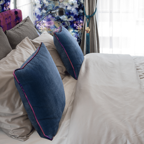 Learn how to layer pillows on your bed from designers Kellie Smith and Melanie Hönig. Get creative and layer pillows in on your bed!